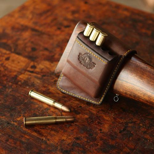 Rifle stock pouch, cartridges, bullets, leather product, handcrafted, yellow stitching, logo, gun, rifle stock