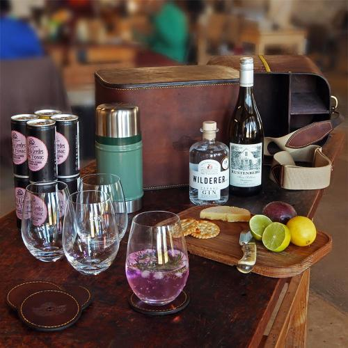 field bar, leather, wine, gin, leather coasters, cutting board, crackers, tonic, cheese, lemons