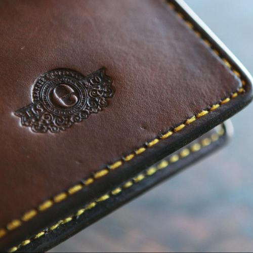 leather wallet, yellow stitching, embossing, logo, wallet
