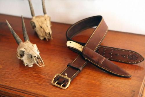 Hunting Belt, leather product, brass finishes, knife sheath, brass stud, yellow stitching, logo, bones, animal skull