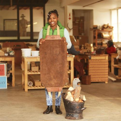 Winterton Firewood Carrier, wood carrier, leather carrier, wood, suede, craftswoman